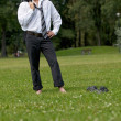 Stock Photo: Businessman standing in park, eyes closed