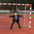 Businessman defending goal - Stock Photo