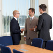 Businessmen talking in conference room — Stock Photo