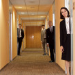 Business standing in corridor — Stock Photo