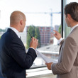 Royalty-Free Stock Photo: Businessmen having discussion at office