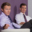 Royalty-Free Stock Photo: Portrait of businessmen sitting at office