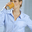 Portrait of businesswoman drinking glass of coffee - Stock Photo