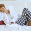 Stock Photo: WomRelaxing on bed