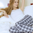 Stock Photo: Young womlying in bed