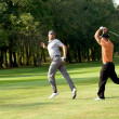 Friends having fun in golf course - 