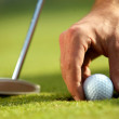 Person holding golf ball, close-up - Stockfoto