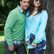 Portrait of young couple posing together by tree — Stock Photo #3814067