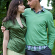 Young couple with arm around and looking at each other — Stock Photo #3814144