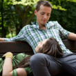 Stock Photo: Girlfriend resting head on boyfriend's lap