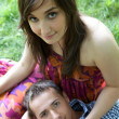 Portrait of young couple relaxing in park — Stock Photo #3814212
