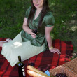 Elevated view of young woman holding wineglass, sitting in park — Stock Photo #3814235