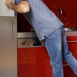 Young man looking in refrigerator — Stock Photo