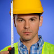 Portrait of architect in hardhat holding tape measure — Stock Photo