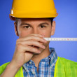 Stock Photo: Portrait of architect in hardhat holding tape measure