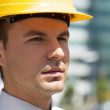 Royalty-Free Stock Photo: Architect in hardhat at construction site