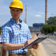 Portrait of architect holding clipboard and looking away — Stock Photo #3814587