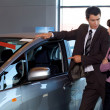 Car salesman conversing with female customer — Stock Photo