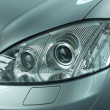 Stock Photo: Close-up of headlight of car