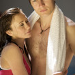 Young sportive couple relax at swimming pool — Stock Photo #3815689
