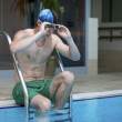 Young man in pool — Foto de Stock