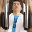 A young man exercising at gym — Stock Photo