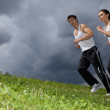Young couple exercising in park - Stockfoto
