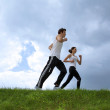 Young couple exercising in park — Stock Photo