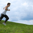 Stock Photo: Young man exercising in park