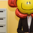 Stock Photo: Business person holding balloon, midsection