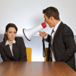 Businesswoman shouting at businessman through megaphone — Stock Photo