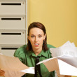 Portrait of businesswoman holding documents at office — Stock Photo #3817505