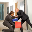 Office accident - businessman helping his coleague — Stock Photo