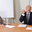 Businessmen having fun at board room — Stock Photo #3818398