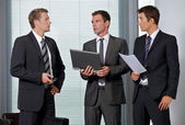 Businessmen conversing in office — Stock Photo