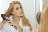Woman brushing hair — Stock Photo