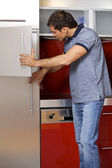 Young man looking in refrigerator — Foto Stock