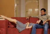 Woman sleeping on husband's lap in hotel room — Stock Photo