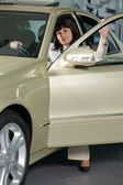 Young woman sitting in new car — Stock Photo
