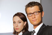 Portrait of businessman and woman in contemplation — Stock Photo