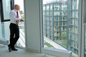 Young businessman looking thru window — Foto de Stock