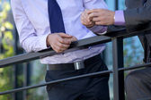 Businessmen standing by railing — Stock Photo