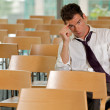 Bored Businessman sitting at conference room — Stock Photo