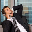 Businessman using telephone in office, smiling — Stock Photo