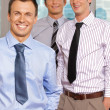 Three businessmen smiling at office, portrait — Stock Photo