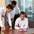 Stock Photo: Businessmen working in office