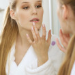 Woman reflection in mirror - Stock Photo