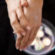 Close-up of woman rubbing lotion on hands — Stock Photo