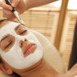 Close-up of young woman receiving beauty treatment in spa - Stock Photo