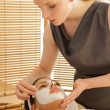Stock Photo: Young woman receiving facial in spa